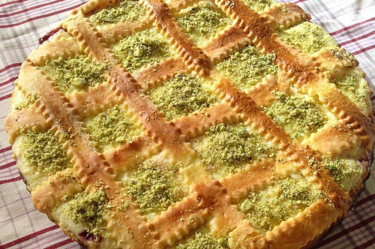 Crostata di ricotta con marmellata di lamponi e granella di pistacchio - Osteria Mastro Titta - La fraschetta nel cuore di Ariccia